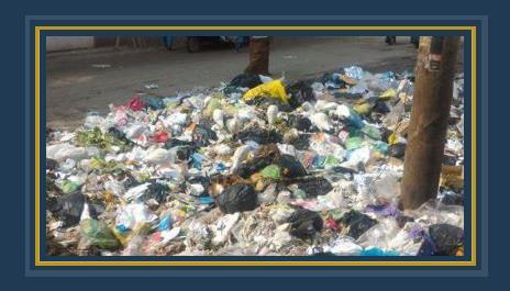 أكوام القمامة فى شارع مدرسة الفردوس
